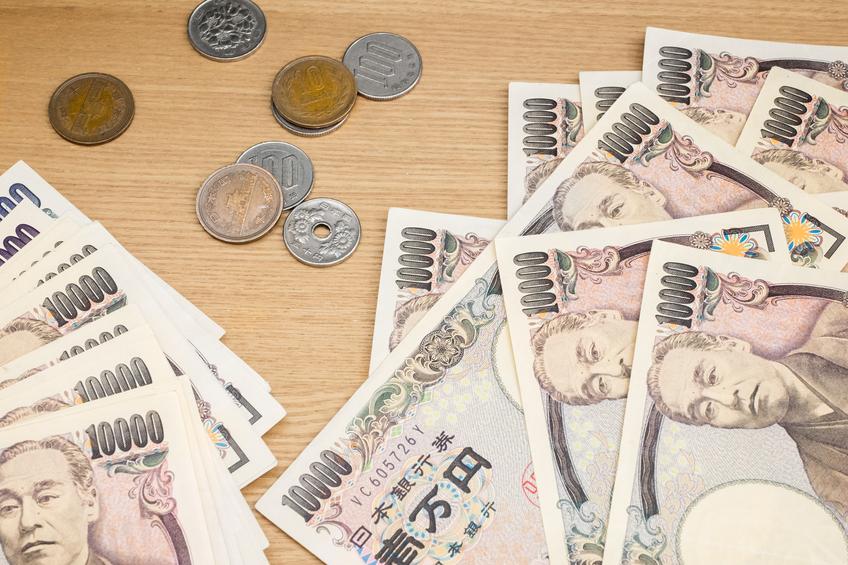 Japanese Yen on wood background