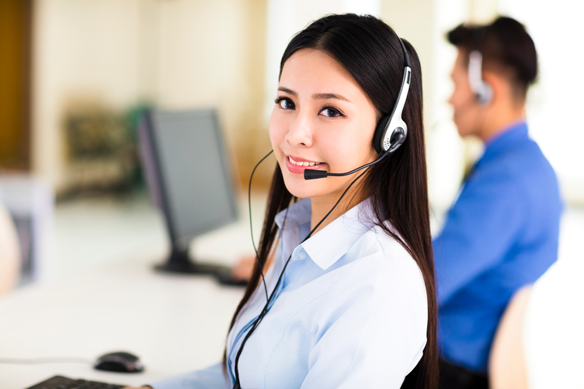 Beautiful call center agent working in office