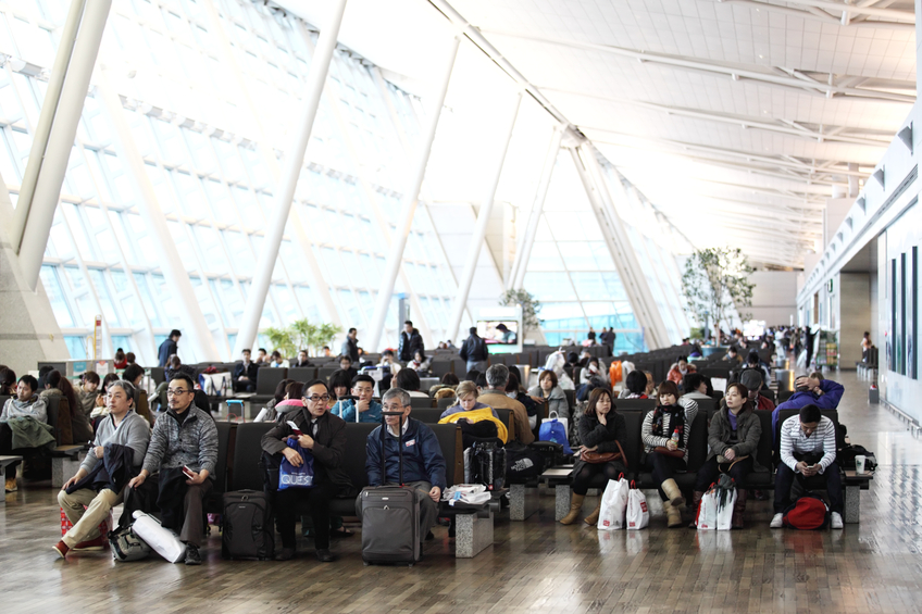 Seoul, Korea - February 17, 2012: Passengers sitting in a departure lounge of Incheon International Airport and waiting to board their flight